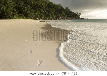 Footprints at the beach at Seychelles islands