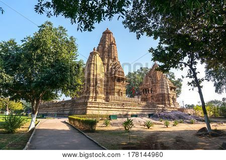 Old Hindu Temple, Built By Chandela Rajputs, At Western Site In India's Khajuraho Framed By Trees.
