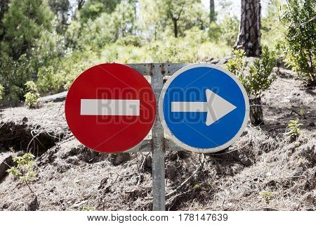 Traffic signs prohibited and driving direction in the forest