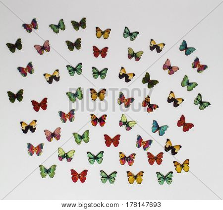 Lots of wooden butterfly buttons flying everywhere