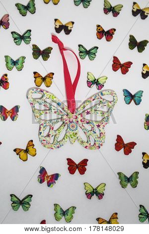 A large handcrafted butterfly amoungst smaller butterfly buttons.