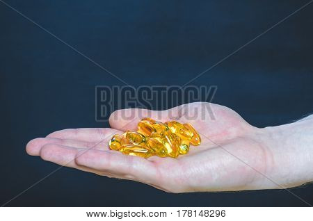 Capsules Of Fish Oil Of The Palm In The Hand Medicine
