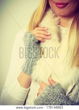 Sensitive Female Hands With Gray Gloves.
