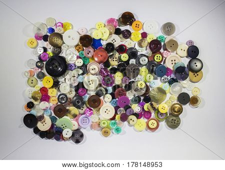 Lots of miscellaneous buttons on a white background