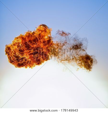 Fireball explosion. Isolated on blue sky background