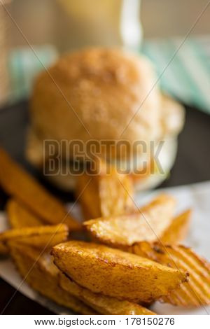 Burger And Hand Cut Fries On A Plate.