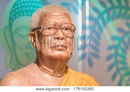 BANGKOK-JAN 29: A waxwork of Buddhadasa Bhikkhu on display at Madame Tussauds on January 29 2016 in Bangkok Thailand. Madame Tussauds' newest branch hosts waxworks of numerous stars and celebrities