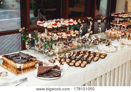Eclairs, Traditional French Dessert. White Table