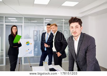 Businessman  looking stand on  background of business team the office.