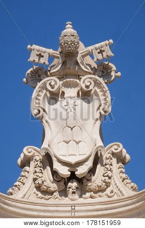 ROME, ITALY - SEPTEMBER 02:  Alexander VII Coat of Arms, fragment of colonnade of St. Peters Basilica. Papal Basilica of St. Peter in Vatican, Rome, Italy on September 02, 2016.