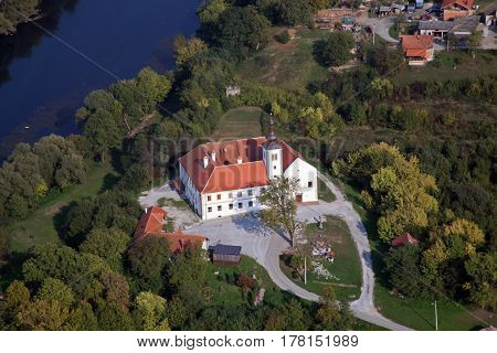 KAMENSKO, CROATIA - OCTOBER 29: Parish Church of Our Lady of snow and Pauline monastery in Kamensko, Croatia on October 29, 2009
