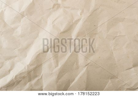 Background from brown wrinkled spotted paper. Top view