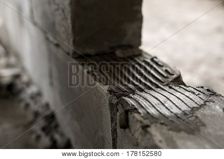 A wall of aerated concrete blocks close up shot in studio being repaired