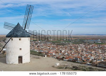 Old white windmill at a viewpoint on the hill near Consuegra (Castilla La Mancha Spain) a symbol of region and journeys of Don Quixote (Alonso Quijano).
