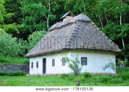 Traditional Ukrainian historical house at museum of Ukrainian folk architecture in Pirogovo village Kiev Ukraine.