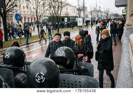 Minsk Belarus - March 25 2017 - Special police unit with shields against ordinary citizens and protesters. Belarusian people participate in the protest against the decree 3 Lukashenko and the current authorities.