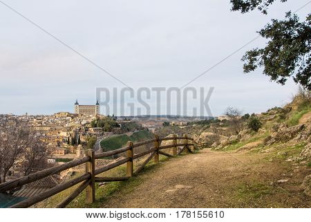 A path over the hill with a view to Toledo Alcazar evening at surroundings of Toledo Castilla la Mancha Spain.