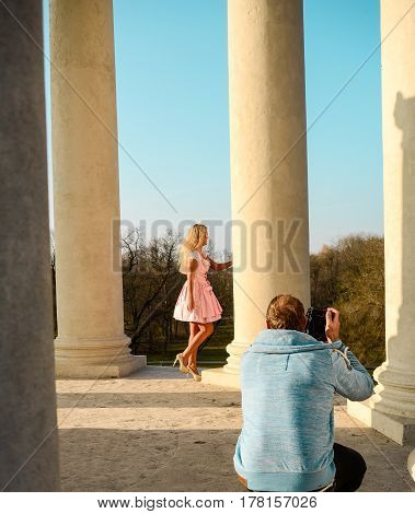Munich,Germany-March 23,2017:A photographer takes pictures of a model at the Monopteros in the Englischer Garten