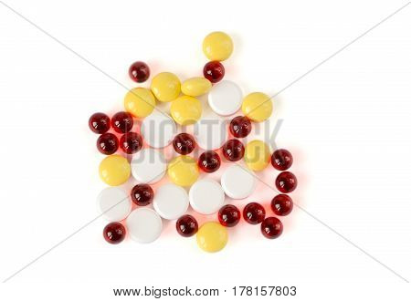 Colored pills on a white background, high angle view