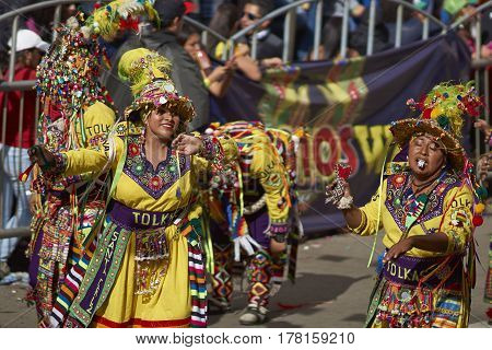 ORURO, BOLIVIA - FEBRUARY 25, 2017: Tinkus dancers in colourful costumes performing at the annual Oruro Carnival. The event is designated by UNESCO as being Intangible Cultural Heritage of Humanity.