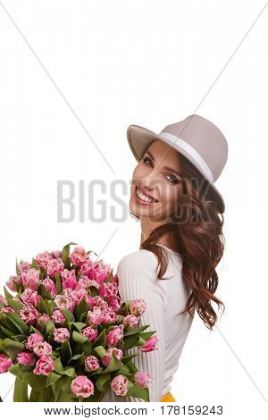 portrait of a beautiful young woman with purple tulips standing on the white background