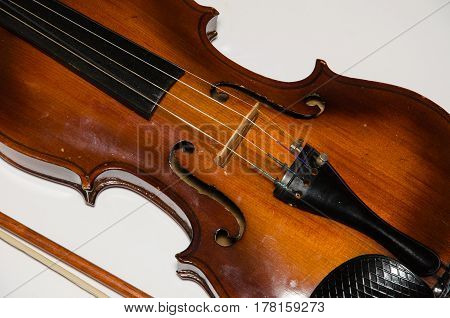 Detail of vintage violin over white background