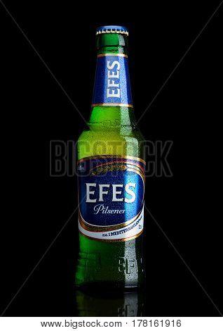 London,uk - March 23, 2017 : Bottle Of Efes Pilsner Beer On Black. Efes Pilsener Is The Flagship Pro