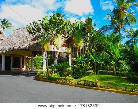 Punta Cana, Dominican republic - February 02, 2013: The main entrance at VIK Arena Blanca hotel under palms near the beach