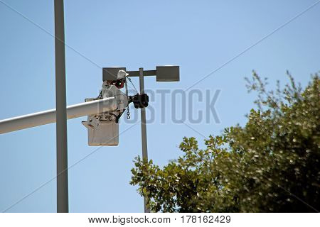 a worker in lift bucket repairing street light pole