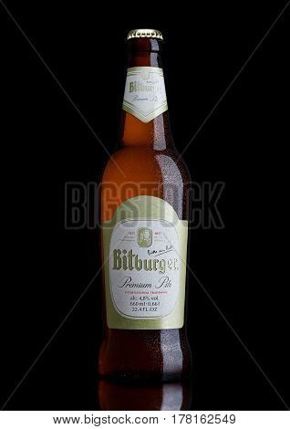 London, United Kingdom - March 23, 2017: Bottle Of Bitburger Beer On Black.bitburger Brewery Is A La