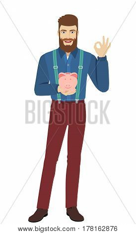 Hipster holding a piggy bank showing a okay hand sign. Full length portrait of hipster in a flat style. Vector illustration.