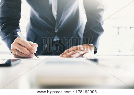 Businessman Signing Contract Making A Deal.