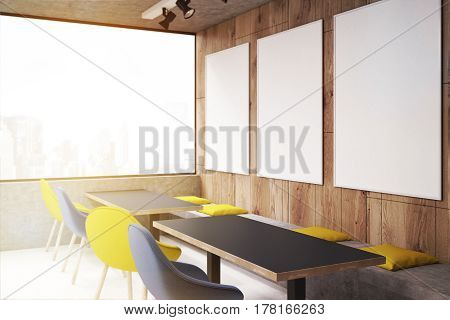 Corner of a cafe interior with yellow and blue chairs near long black tables there are posters on wooden walls. 3d rendering mock up toned image