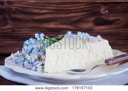Slice Homemade Japanese Cheesecake wih forget-me-nots flowers