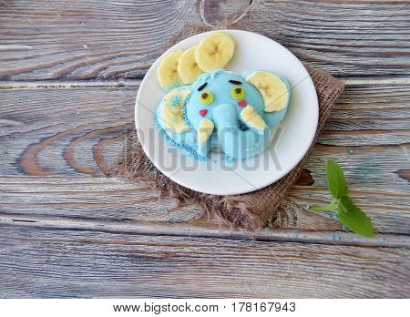 The elephant is made of ice cream. A creative dessert for children and good mood.