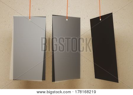 Three empty black price tags on light background. Advertisement concept. Mock up 3D Rendering