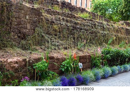 Roman wall in the city center of Exeter. A garden is made on the wall. Devon. England