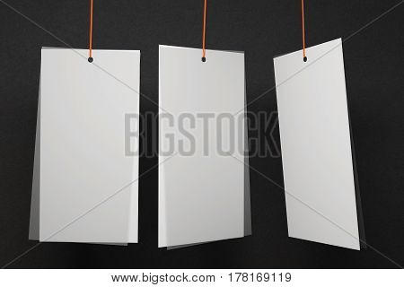 Three blank white price tags on dark background. Advertisement concept. Mock up 3D Rendering