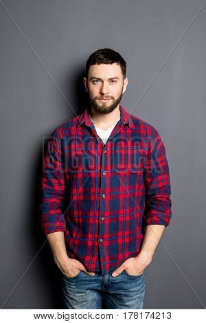 Happy Young Man. Portrait Of Handsome Young Man In Casual Shirt With Hands In Pockets And Smiling