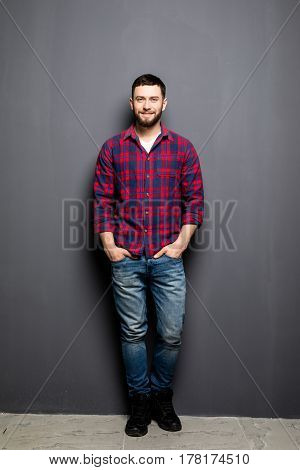 Full Portrait Of Handsome Young Man In Casual Shirt With Hands In Pockets And Smiling While Standing