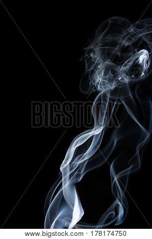wavy white smoke on a black background