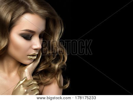 Beauty Portrait Of Young Woman With Golden Makeup