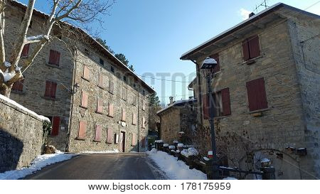 Old stone buildings in a small town in Italy