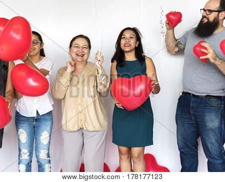 Group of Diverse People Holding Heart Balloons Cheerful