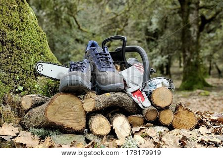 Shoes, Gloves And Safety Goggles For Safe Use Of A Chainsaw.