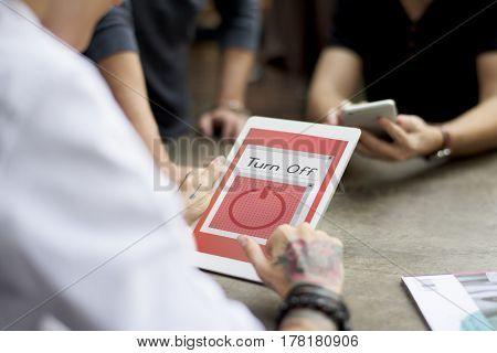 Man holding digital tablet with power button on the screen