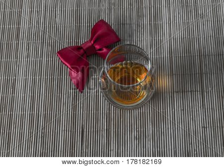 Top View For A Glass Of Whiskey Single Malt, Red Bow