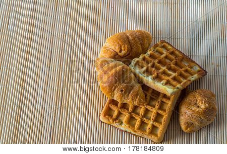Fresh Croissants And Delicious Waffles On Bamboo Mat, Bakery