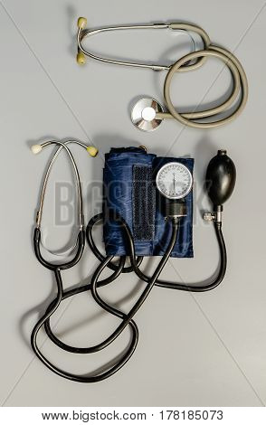 Medical instruments: stethoscope and tonometer. Taken from above. Large.