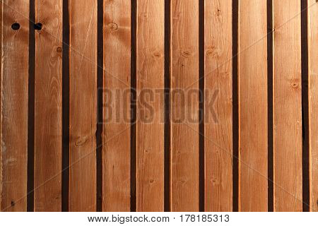 Brown Wooden Boards Illuminated By The Setting Sun